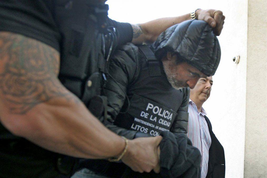 Baratta llevado por la Policía a los tribunales de Comodoro Py.