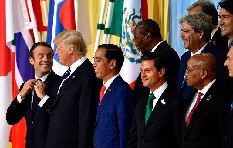 Presidentes del G-20 en Alemania en julio de 2017. Macron y Trump en primera fila.