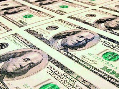 El dólar al alza: subió 7% en lo que va de 2014 y va por más